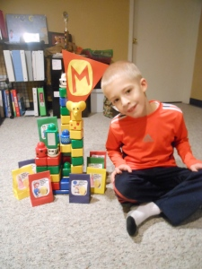 TJ with his castle and bags of gold!