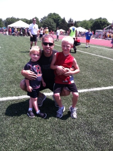 daddy and boys at the track meet